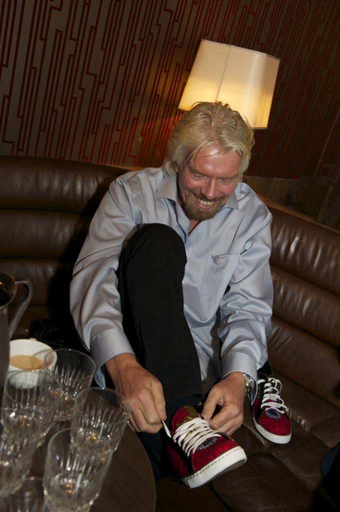 Richard Branson trying on an Hesey footwear