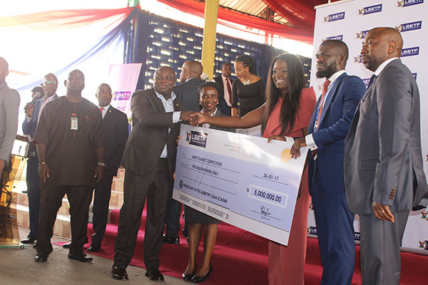 Presentation of Cheque to one of the beneficiaries of the first cohort