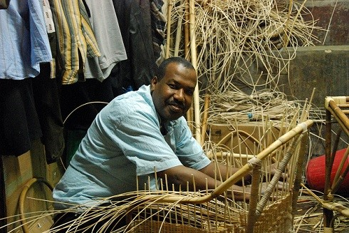 Egyptian entrepreneur in his weaving business